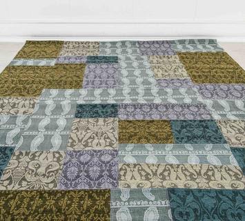 come posizionare i tappeti in casa